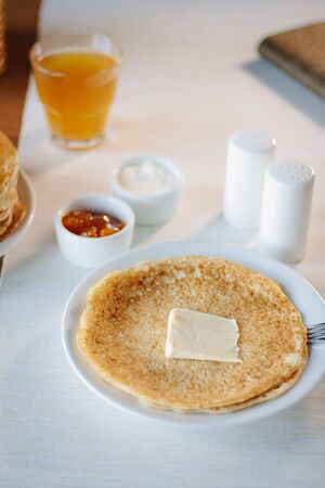 Butter and pancakes - russian national food on restaurant 写真素材