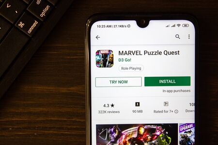 Ivanovsk, Russia - July 21, 2019: Marvel Puzzle Quest app on the display of smartphone