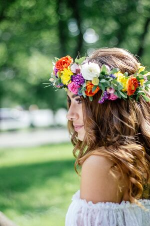 Beautiful bride with flower wreast on hairs.