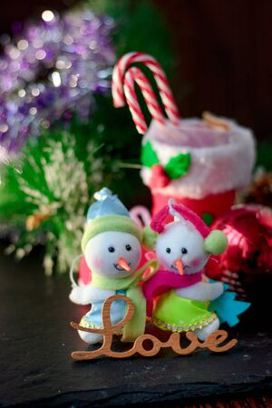 Pair of christmas snowmans with word Love near them 写真素材