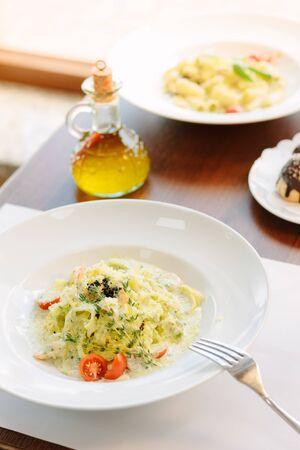 Traditional italian fettuccine pasta with pesto in italian restaurant 写真素材