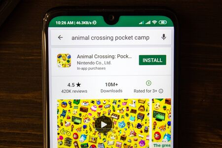 Ivanovsk, Russia - July 21, 2019: Animal Crossing Pocket Camp app on the display of smartphone 新聞圖片