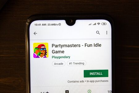 Ivanovsk, Russia - July 21, 2019: Partymasters - Fun Idle Game app on the display of smartphone 新聞圖片