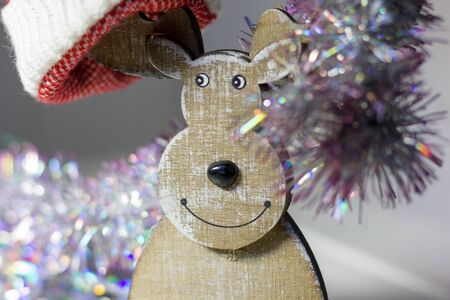 wooden christmas deer with eyes and nose.
