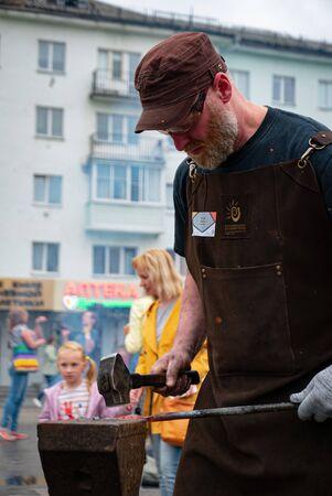 Ryazan, Russia - July 27, 2019: Blacksmith on the forge festival Editöryel
