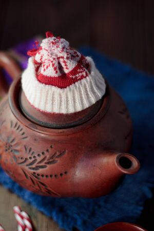 Christmas teapot with the red santa hat on it