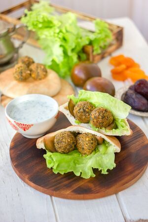 Falafel with lettuce and vegetables in pita bread