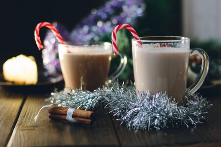 Glass filled by the eggnog - christmas punch. 版權商用圖片