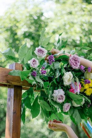 Florist working with flowers at green park or garden