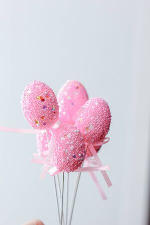 Pink easter eggs on a sticks over the white background 版權商用圖片