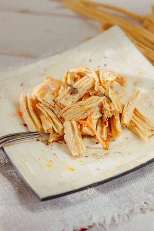 Yuba or fuju salad in a white bamboo plate 版權商用圖片