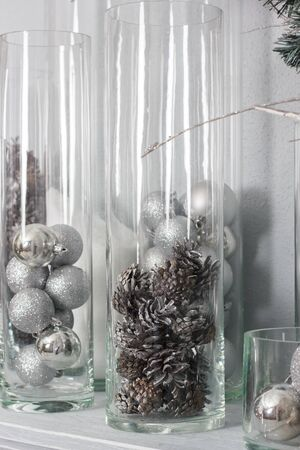 Chirstmas decoration with the pine cones and balls in glass bulbs