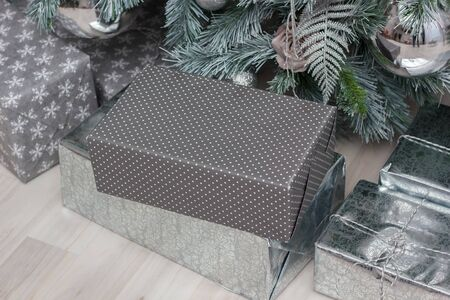 Gifts in a box under the christmas tree