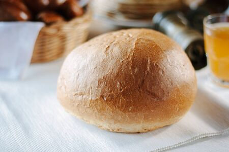 Fresh round bread at the restaurant table.