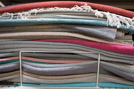 Pile of small welcome carpets or doormats. Banco de Imagens