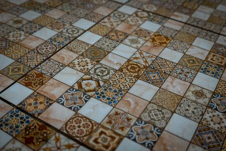 Small tiles of ceramic mosaic on the wall. 版權商用圖片