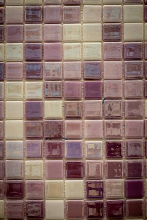 Purple ceramic mosaic on the wall as background. 版權商用圖片