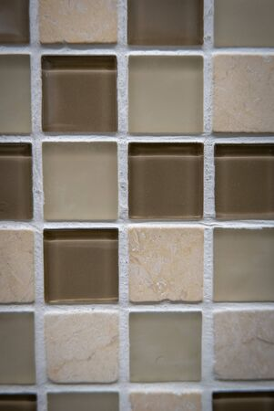 Brown ceramic mosaic on the wall as background. 版權商用圖片