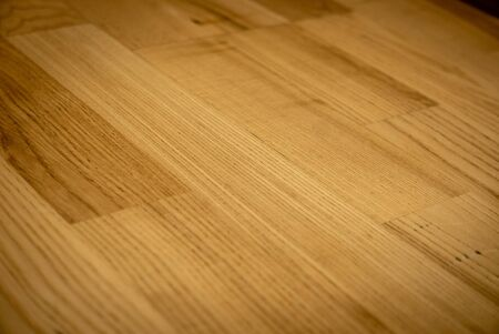 Yellow or light brown parquet texture as a background. 版權商用圖片