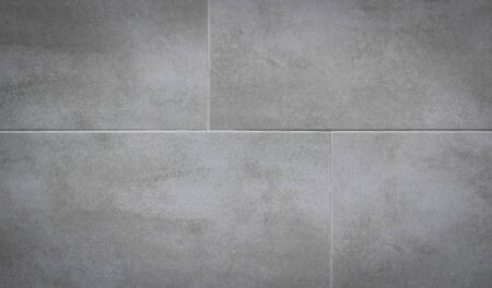 Gray ceramic tiles on the wall.