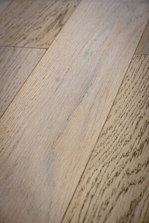Dark brown wooden parquet floor texture as background. 版權商用圖片