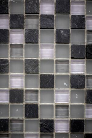 Gray, white and black ceramic mosaic on the wall as background. 版權商用圖片