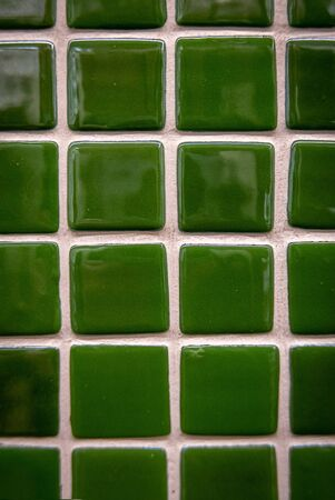 Green ceramic mosaic on the wall as background