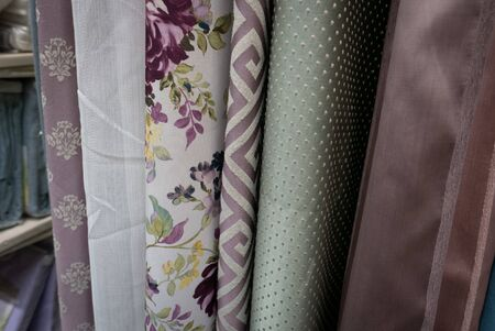 Fabric materials in a shop. Curtains at market