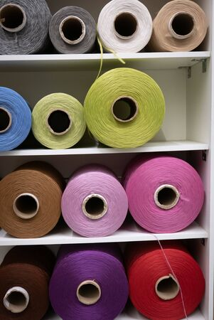 Cotton sewing threaded reels in a sewing shop. 스톡 콘텐츠