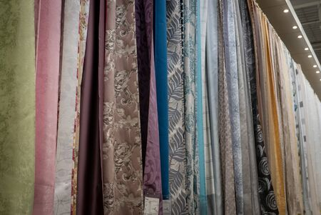 Curtains of different colors and styles in the shop.