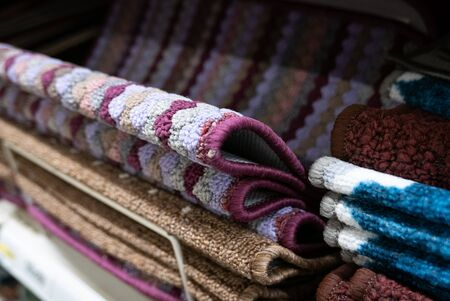 Pile of small welcome carpets or doormats. 스톡 콘텐츠