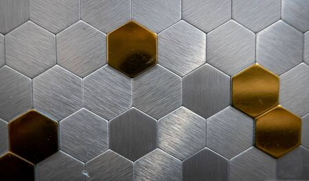 Decorative metal cells on the wall as a background 스톡 콘텐츠