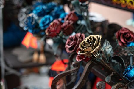 Colored metal roses on the street market Stock Photo