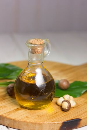 Macadamia oil in a glass bottle. Great photo for your needs.