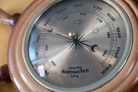 An Old vintage barometer on the wall