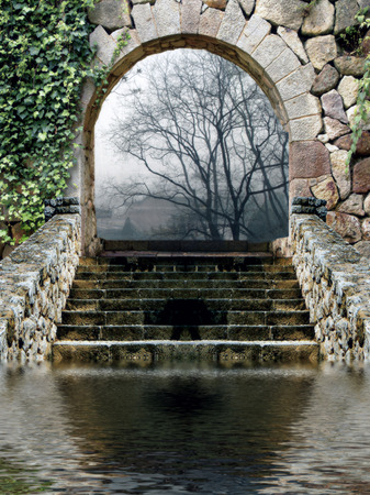an entrance arch with stone wall and stairs leading to a forest