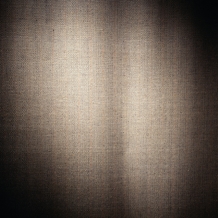 light brown cloth textured material with threads background