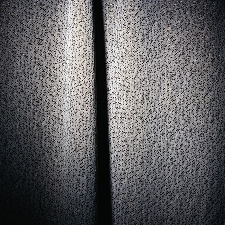 black,white and silver cloth material curtain background with spots Imagens