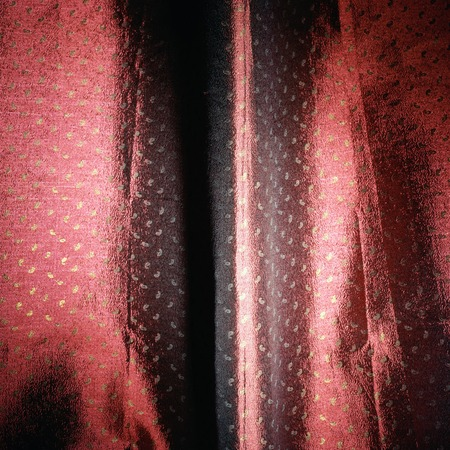 red and maroon shiny cloth material texture with spots background