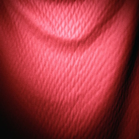 red and maroon shiny cloth curtain material texture background Imagens