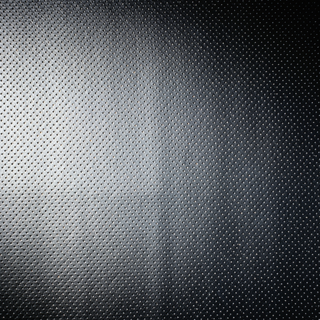 black,white and silver cloth material background with spots Imagens