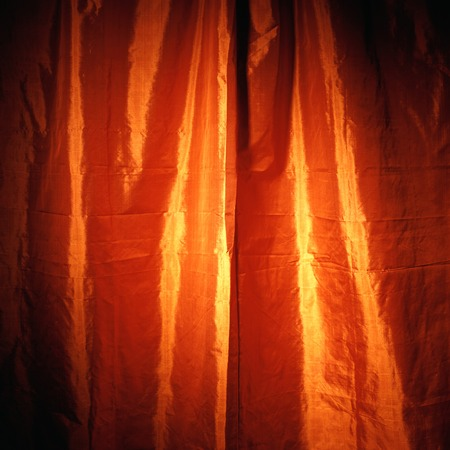 yellow and orange shiny curtain cloth material texture background
