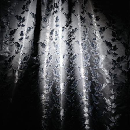 black,white and silver curtain cloth material texture background with leaves patterns in it
