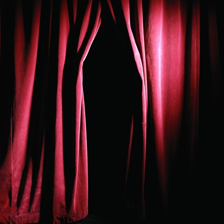 red theatre curtain cloth material texture background with opening in middle