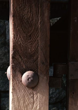 Wooden Japanese detail of a door with bolt and nut background