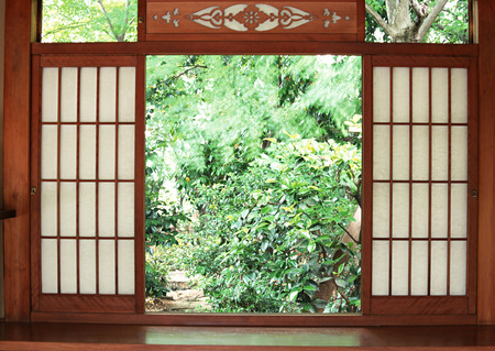 Japanese wooden entrance door background with garden outside Stock Photo
