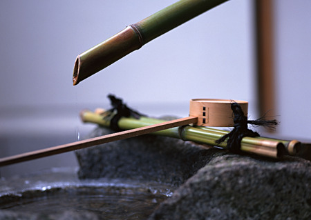 a row of Japanese wooden stick instrument with circular head background