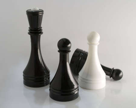 several black and white chess pieces remain alone Stok Fotoğraf