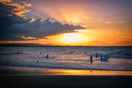 byron: Sunset over the beach at Byron Bay Stock Photo