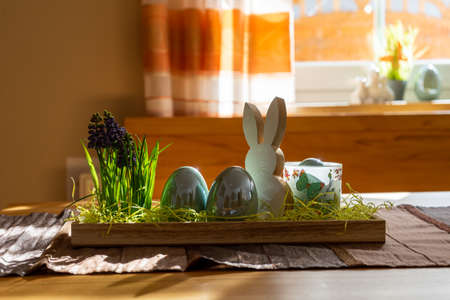 Easter decoration with egg and bunny on a table